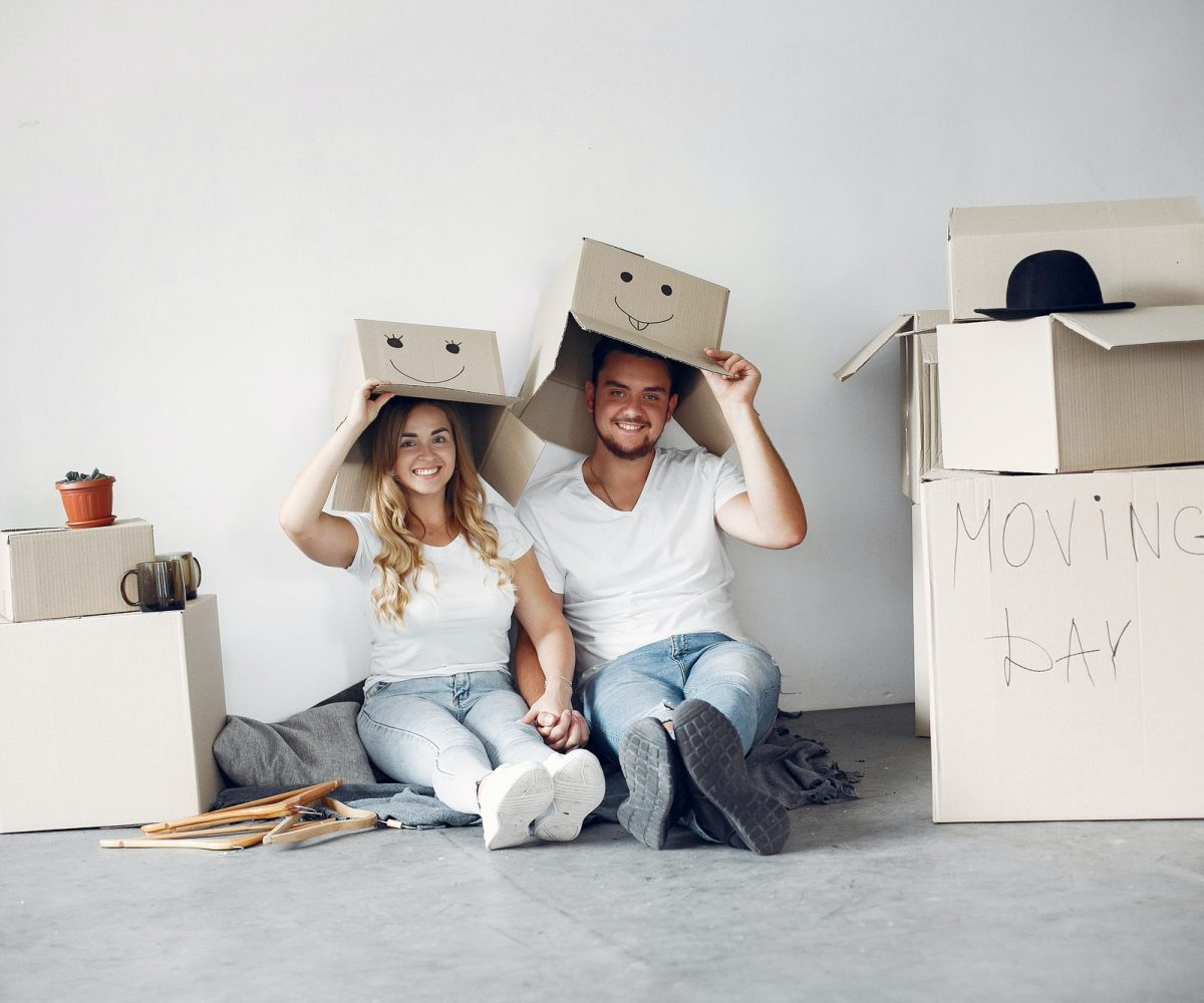 Couple moving and using a boxes